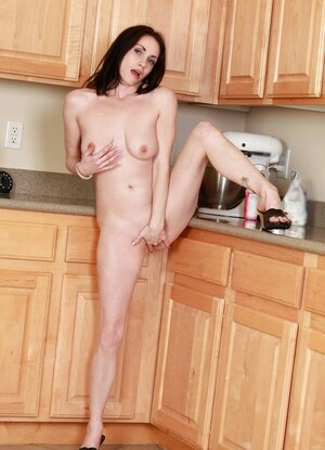 Naughty wife stirs up some sweet juices between her legs