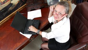 Lovely busty mom unclothes in front of her laptop