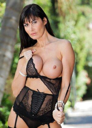 Eva Karera slips off her lace lingerie outdoors unleashing her elegant milf..
